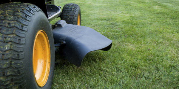Ground level closeup of a ride on mower  - shallow DoF